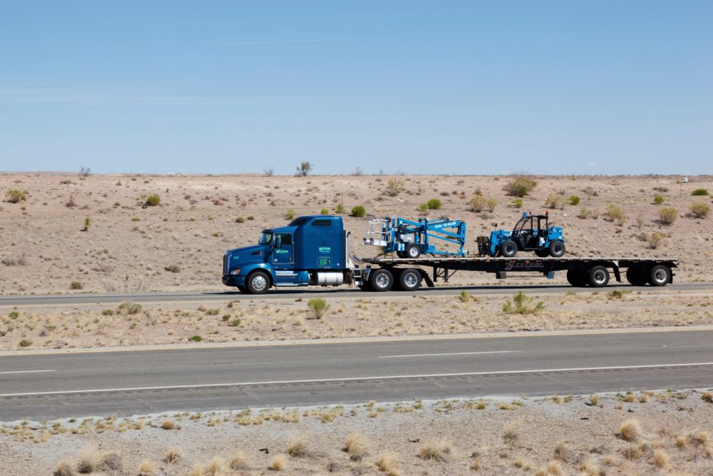 Forklift Transporting, Truck hauling forklifts in transport