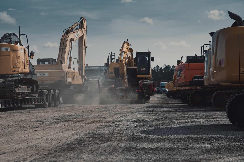 excavators being transported