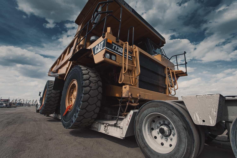 offroad dump truck on trailer